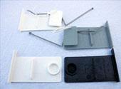 <br><strong>Endkappen für REIBA Flap</strong><br>Set mit 4 Endkappen<br>in den Farben weiß, <br>grau oder dunkelbraun<br>2 mit Feder<br>2 ohne Feder<br>15,00 EUR